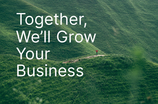 """person on path in green mountains with text """"together we'll grow your business"""""""